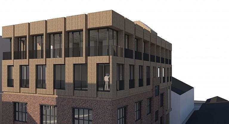 Anbau mit Wohngeschossen an ein Industriegebäude